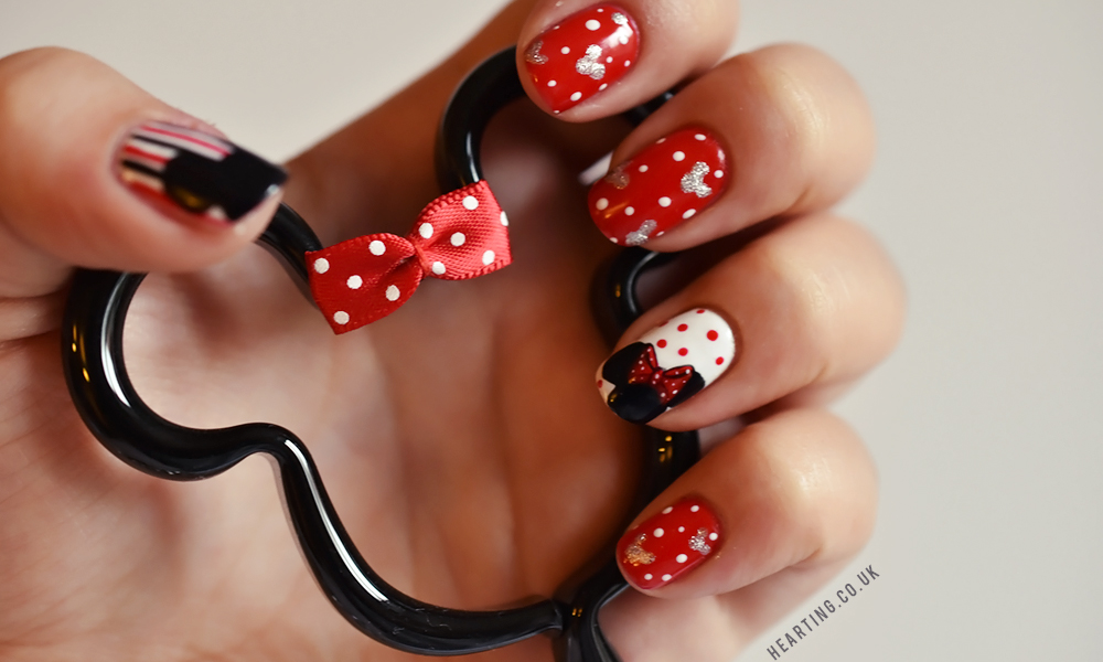 Disney Nails featuring a Mickey and Minnie design in red, white, black and silver
